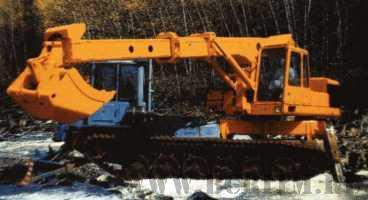 Экскаватор планировщик UDS 114/214 на шасси трактора 662-сб5-03